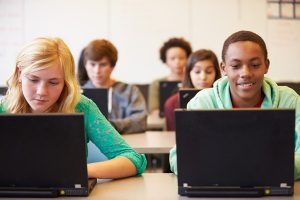 students in class on laptops