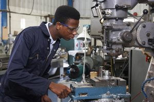 student using a milling machine